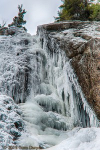 By the time I got to the nature sculpted ice of Roaring Brook Falls, a matter of only minutes, the batteries in my shirt pocket had warmed to normal full strength.